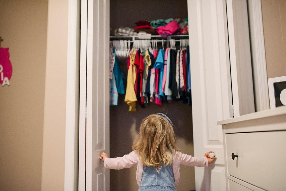 Girl looking in her wardrobe