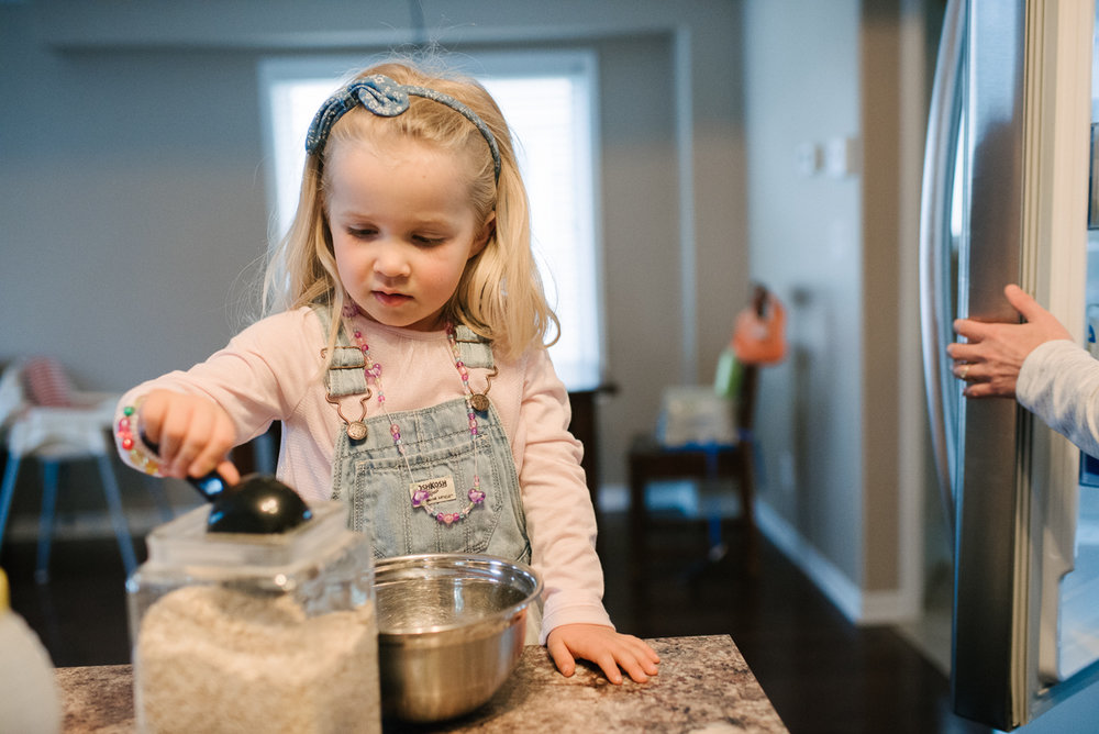 Young girl cooking in the kitchen