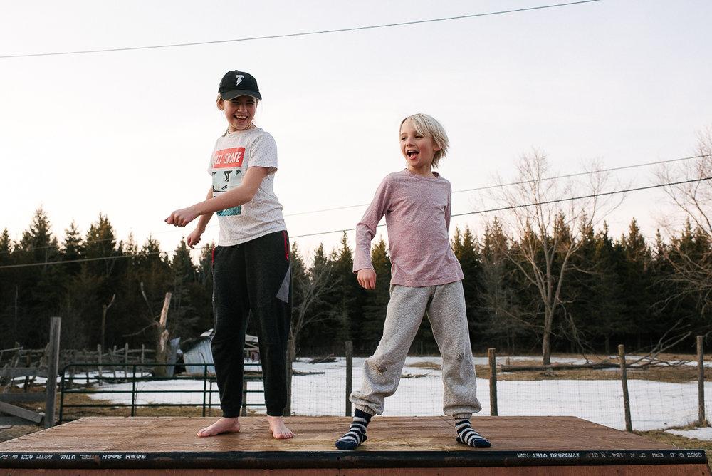Dabbing time on top of the skate ramp, in socks.