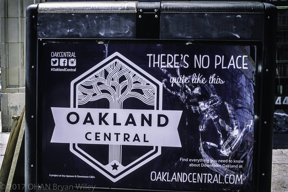 "A ""There's No Place quite like this,"" an Oakland Central banner, gives information on their site to inform people of things to do in downtown Oakland."