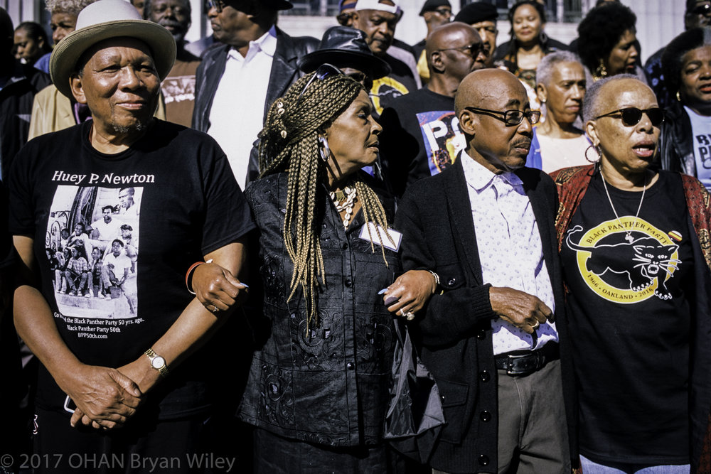 Black Panther members lock arms in unity at the Black Panther 50 year reunion.