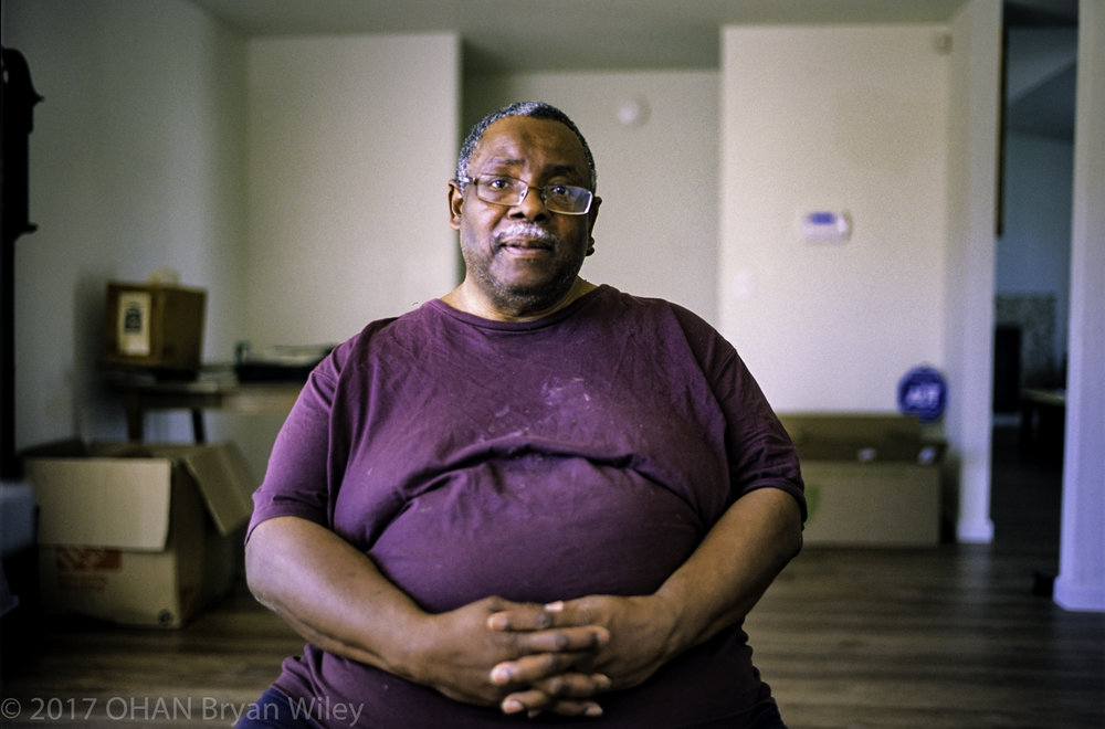 After selling his North Oakland home, Harold Jordan sits in his new home in Sacramento.