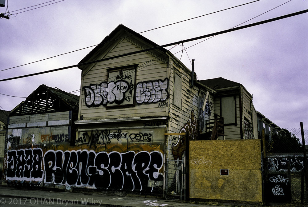 Tagged and dilapidated West Oakland houses sit empty.  What will become of these homes and who will move in?