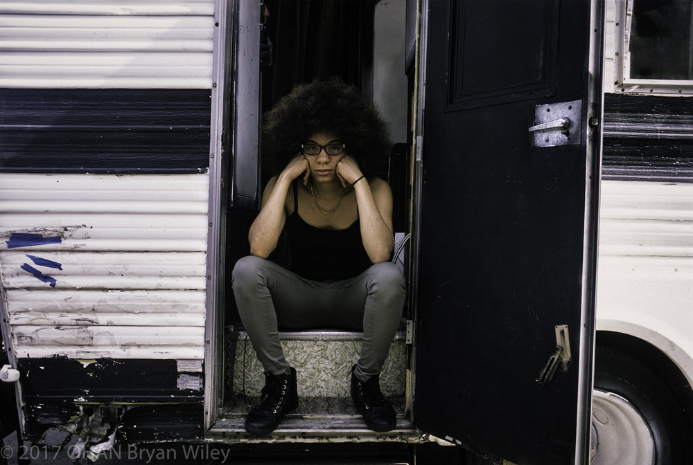 La'Donna Mitchell sits on the steps of her mobile home in West Oakland.
