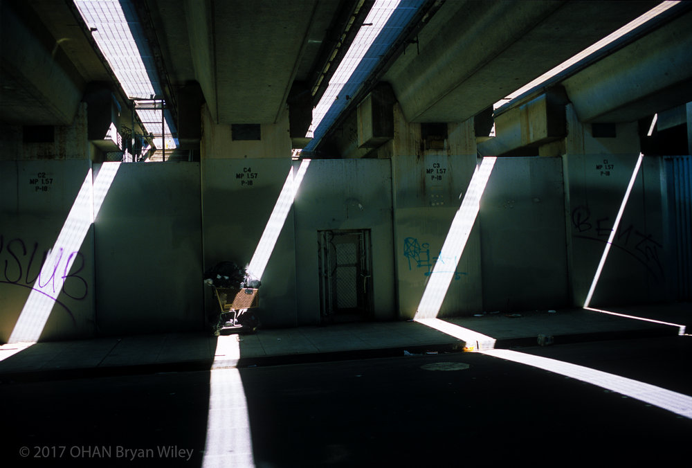 Light beams through this underpass in Temescal that serves as a refuge for the homeless.