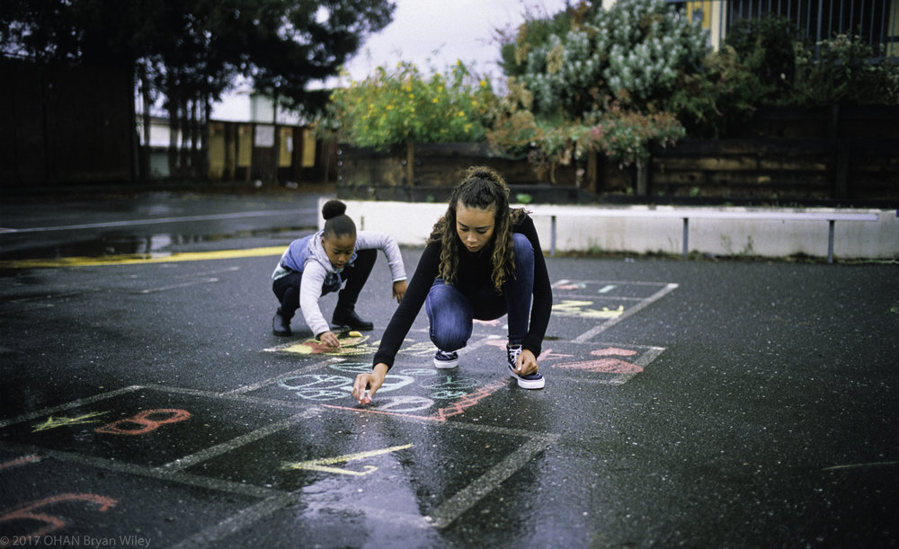 In East Oakland, Sienna Jasmine and Samaya Sage (l to r) draw hopscotch at Cleveland Elementary School.