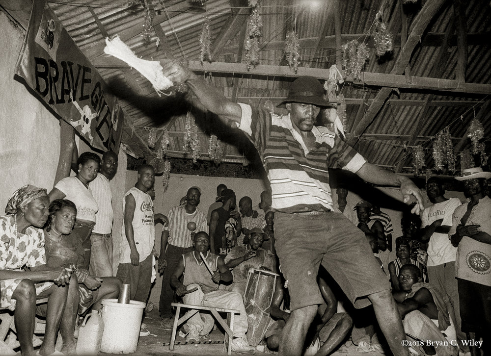 A  man possessed by the spirits of Gede dances at a Vodou ceremony.  Gonaives, Haiti