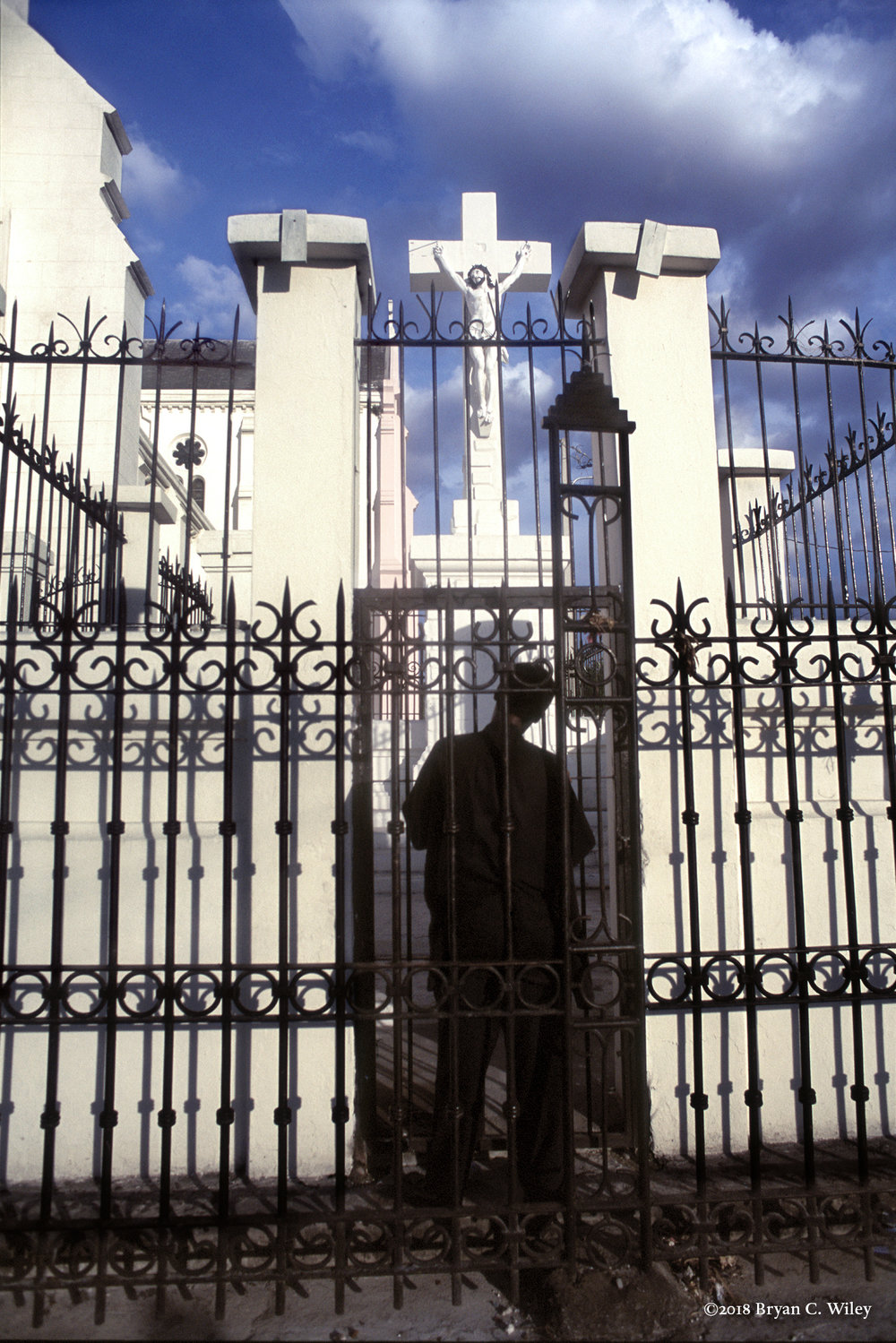 A man prays outside the National Cathedral.  Port-au-Prince, Haiti