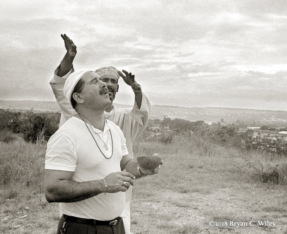 A Babalawo recites the extended chant known as The Mojuba, in recognition of the ancestors, before beginning a ceremony.  La Habana, Cuba