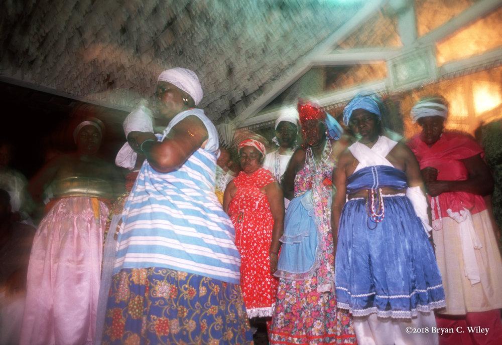 As the women go into trance, they become the Orisha that possesses them.  Salvador do Bahia, Brazil
