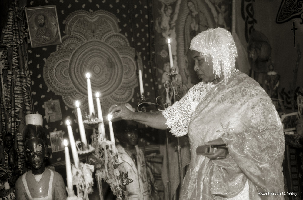 Voodoo Priestess Miriam Chamani lights The Ceremonial Candles during her wedding at the Voodoo Spiritual Temple.   New Orleans, LA