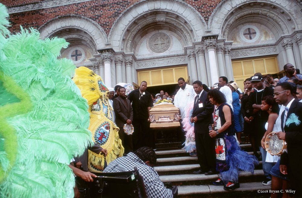 Mardi Gras Indians and other mourners pay respect to their late Chief.  New Orleans, LA