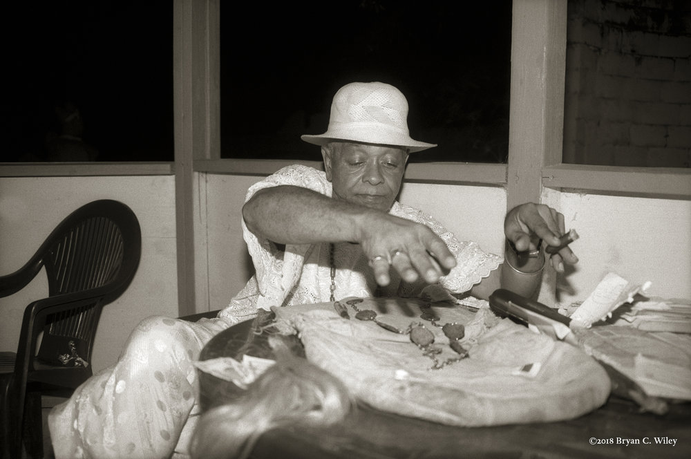 Babalawo Chief Ajamu prepares for divination.  Oyotunji African Village, SC
