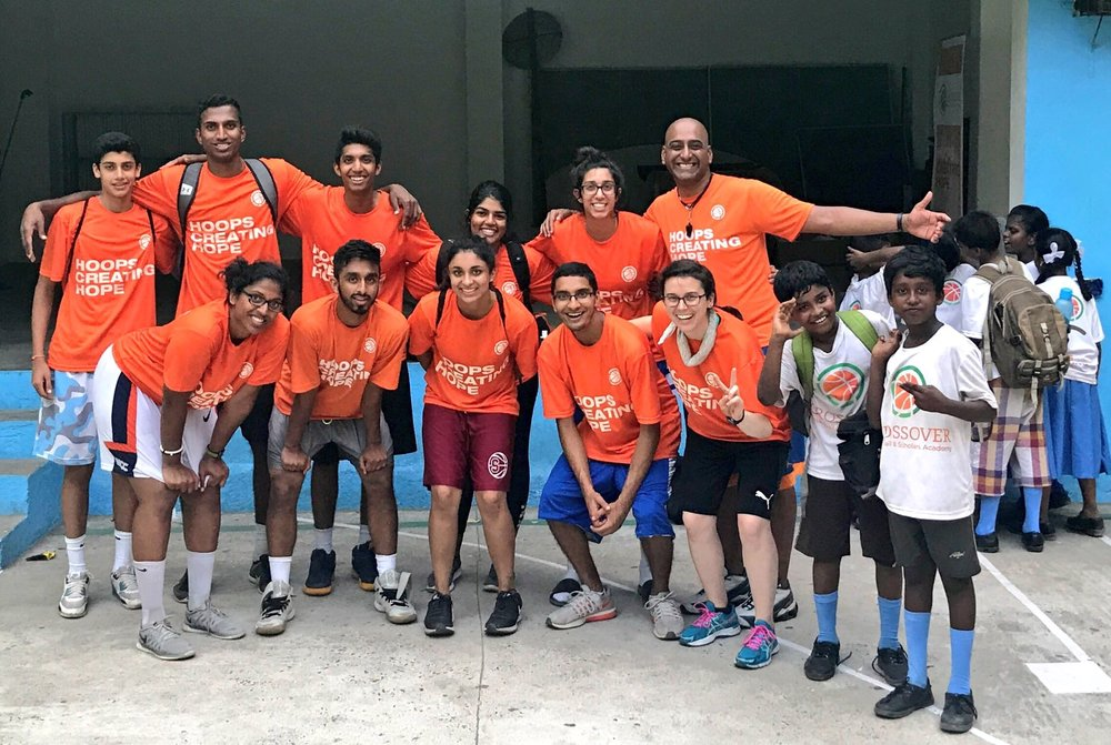 Shaun (back row, far right) with team members and students in Crossover Basketball and Scholars Academy