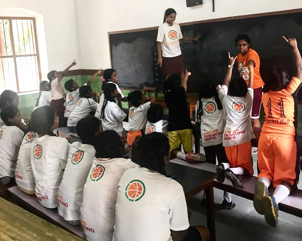 Students in Crossover Basketball and Scholars Academy and a volunteer