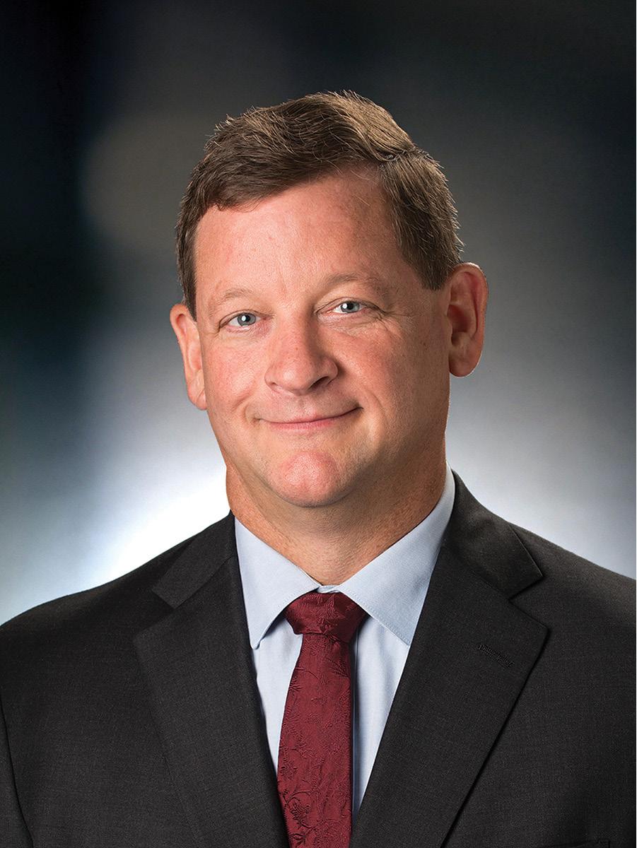 SCOTT GUSTAFSON Chief Operating Officer