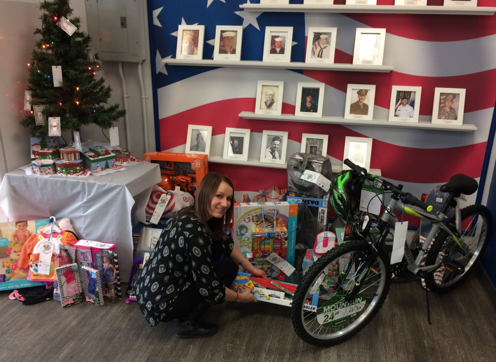 Plant Accountant Alissa Dickson gathers the toys donated by Intervala employees for delivery to the Salvation Army.