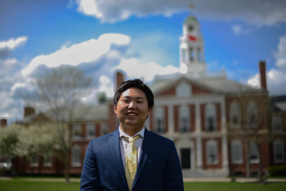 """Tim Han is a third year senior at Phillips Exeter Academy. He has been an active member of a number of student government clubs, such as Model UN and Youth in Government for the last three years. Tim is the Comptroller for PEAMUN and Phillips Exeter MUN's Director of Finances. At PEAMUN, he will also be the chair of the JCC Monopolies Crisis Committee. When he's not MUN'ing, Tim can be found playing monopoly and being called """"overly aggressive""""."""