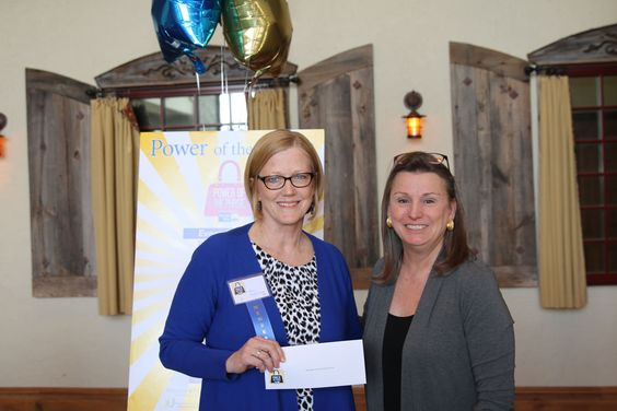 Barrington Area United Way Executive Director  Leslie Luther  presented the grant to  Rita Rippentrop, BYFS' Executive Director
