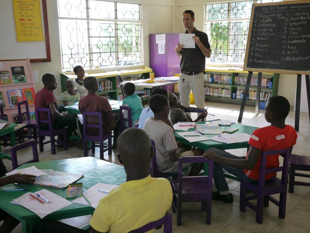 James teaching school-aged children