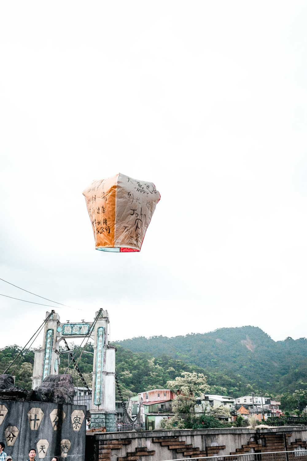 A lantern floats up to the sky