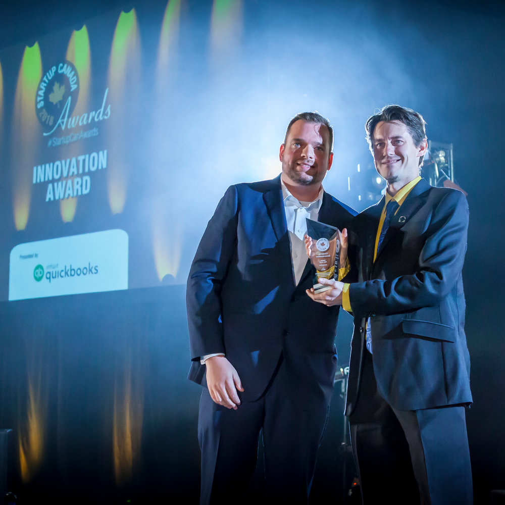 Caption: R. Janzen receiving Innovation of the Year Award, 2018.