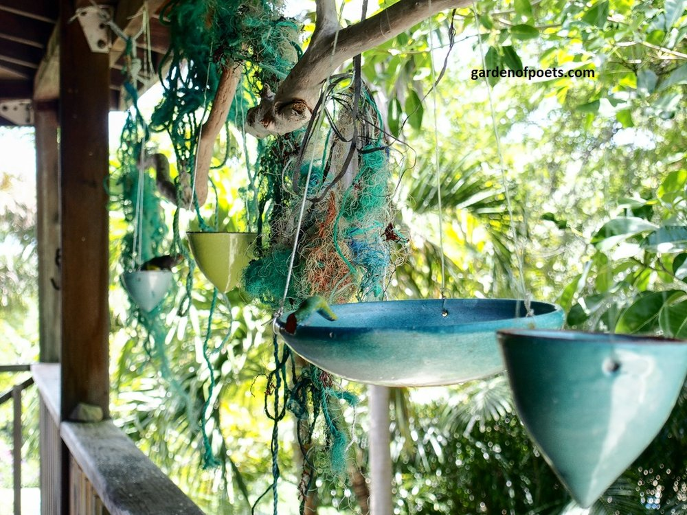 Ceramic bird feeders by  Sarah Fuller  at her home in Antigua. Photo by Jennifer Ritchie.