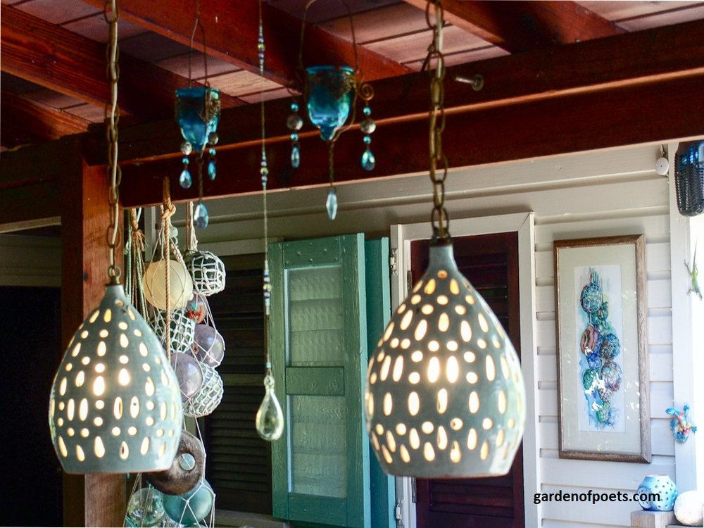 Sarah Fuller Pottery  lights in her Caribbean home. Art by Gilly Gobinet. Fishing floats discovered beachcombing. Spot the lizard! Photo by Jennifer Ritchie.
