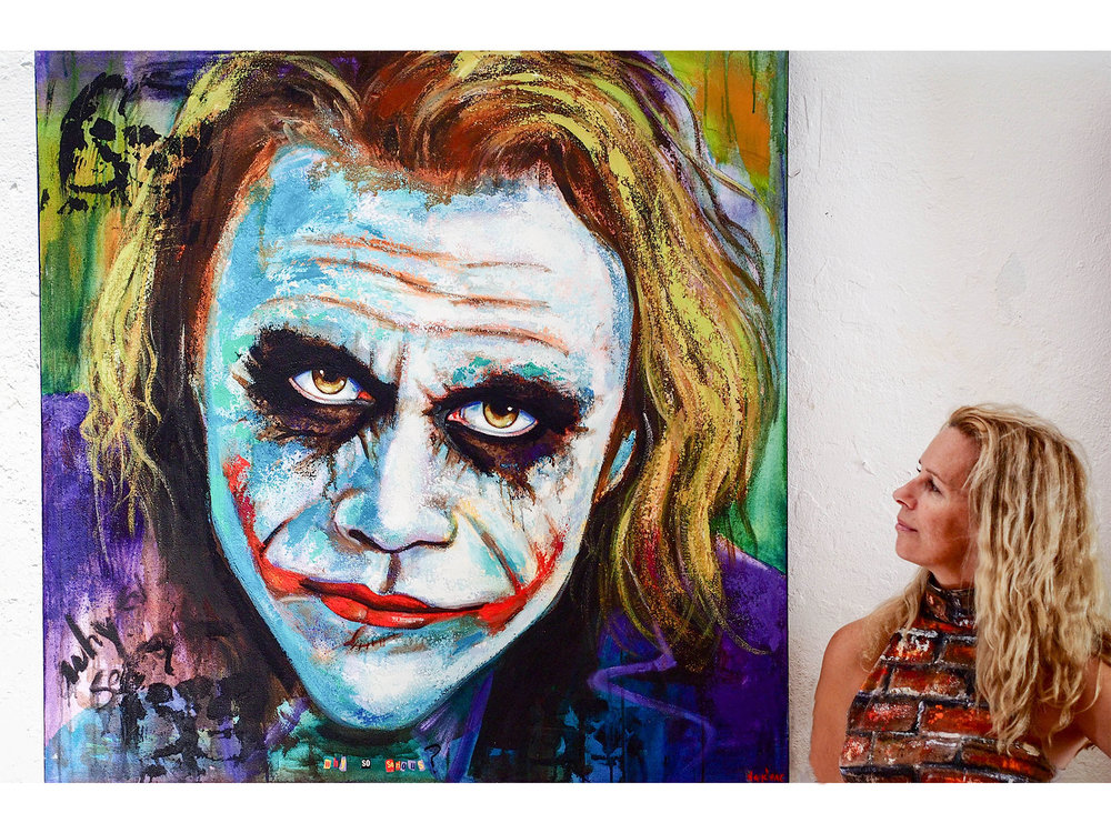 Naydene Gonnella with her painting of Heath Ledger as The Joker, with the poignant caption 'Why so Serious?'. Photo by Jennie Ritchie.