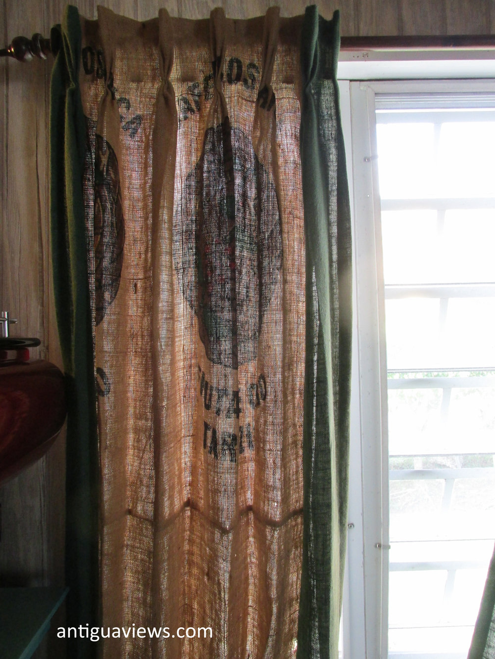 Curtains made from the coffee bean sacks at the Carib Bean coffee company in Antigua. Photo by Jennie Ritchie.