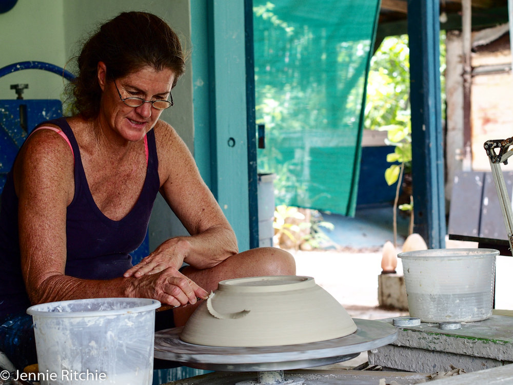 Nancy Nicholson working at her pottery wheel. Photo by Jennie Ritchie.