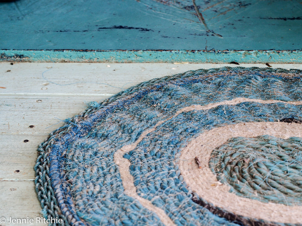 Blue handmade rope mat at the home of Nancy Nicholson. Photo by Jennie Ritchie.