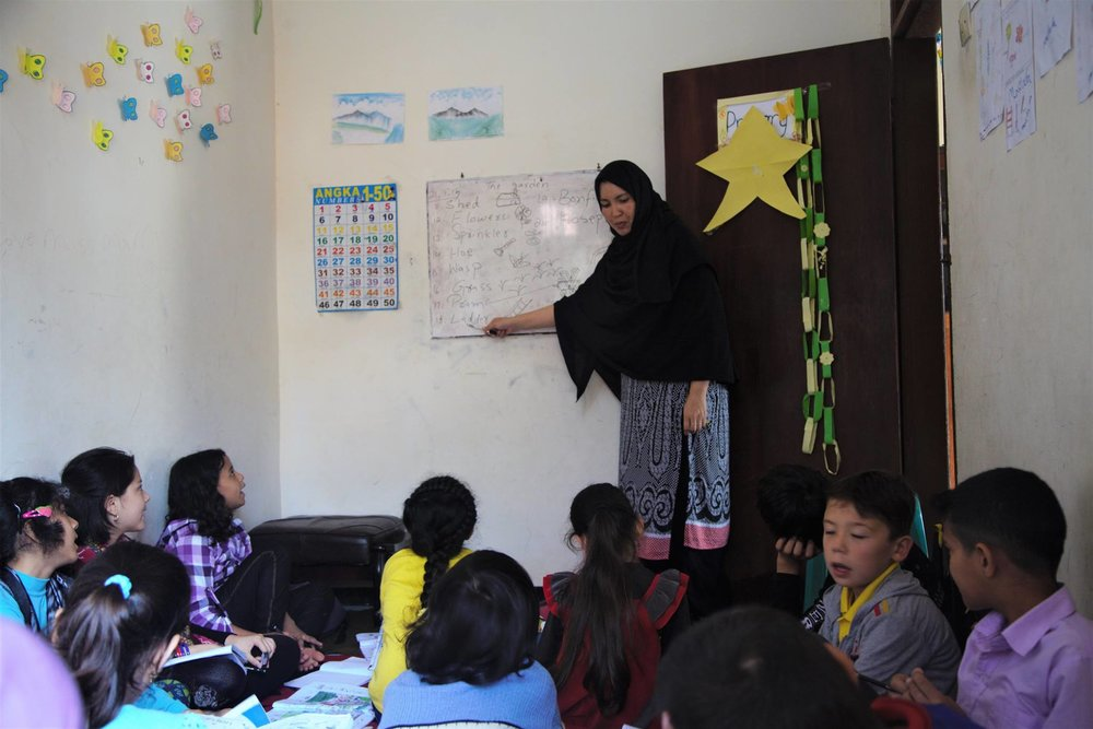 Our iron lady, Tahira, teaching the kids. The woman who left Jakarta to enrol her children in Cisarua.
