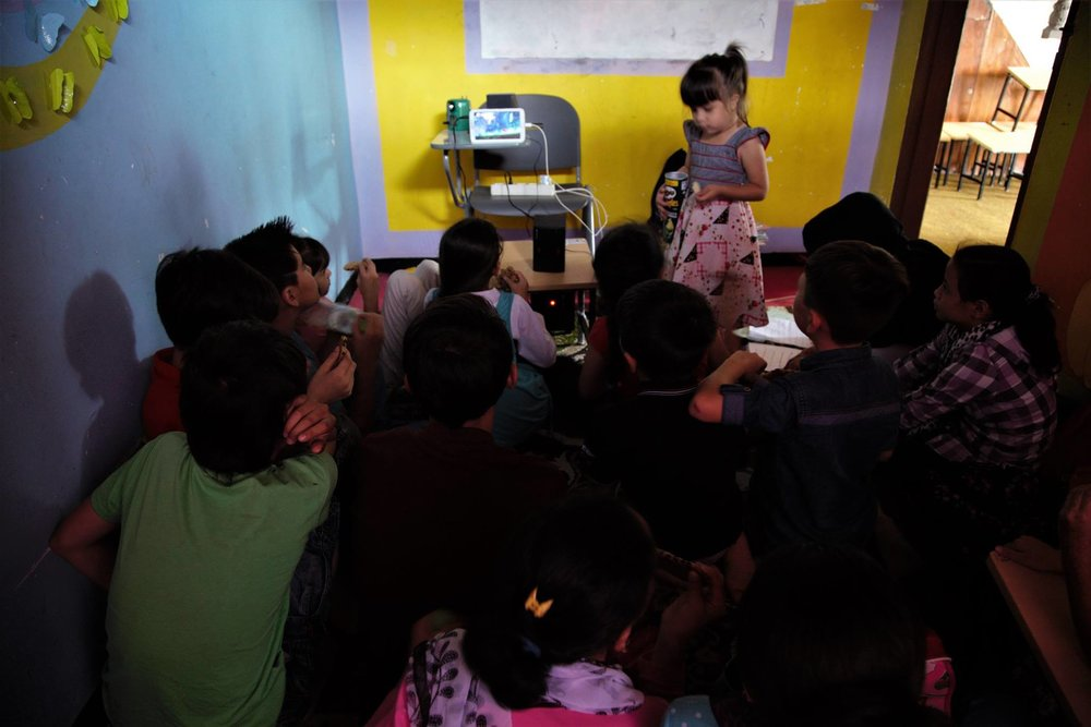 Our teachers, with limited resources, offered their tablets to be used as screen educational materials for the students. Looks like a mini cinema, even Natiqa enjoyed these sessions with older kids.