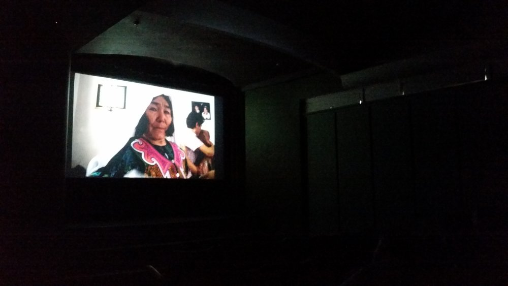 Khadim's mum on the screen at UTS screening.jpg