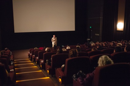 Professor Bill Maley presents to a full audience before a screening in Canberra.jpg