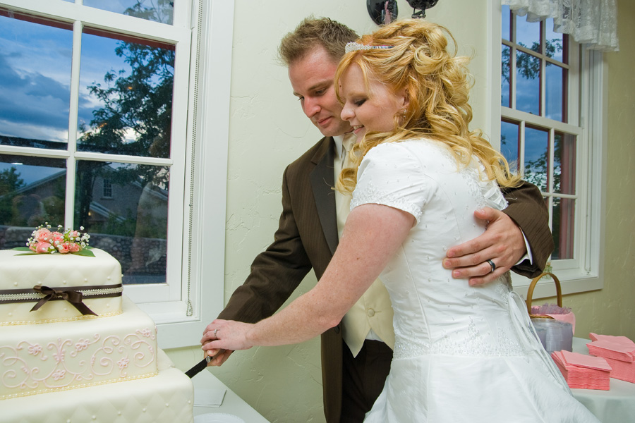 bride-and-groom-cutting-wedding-cake-smoot-hall.jpg