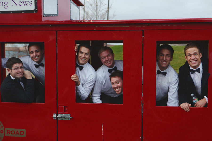 groom-and-groomsmen-inside-train-car.jpg