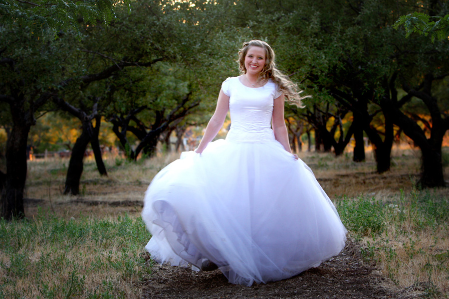 bride-walking-through-orchard.jpg