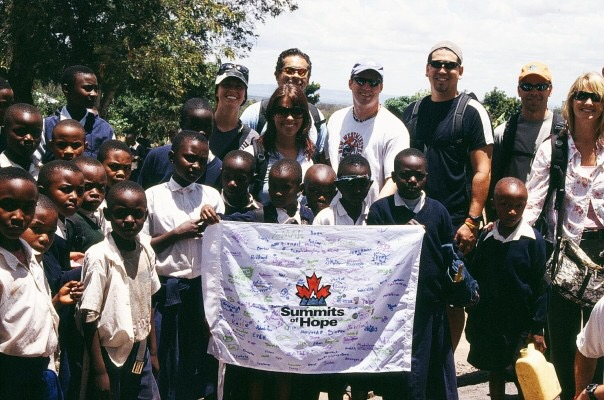 Summits of Hope hikers and the kids in Tanzania after climbing Mt Kilimanjaro.