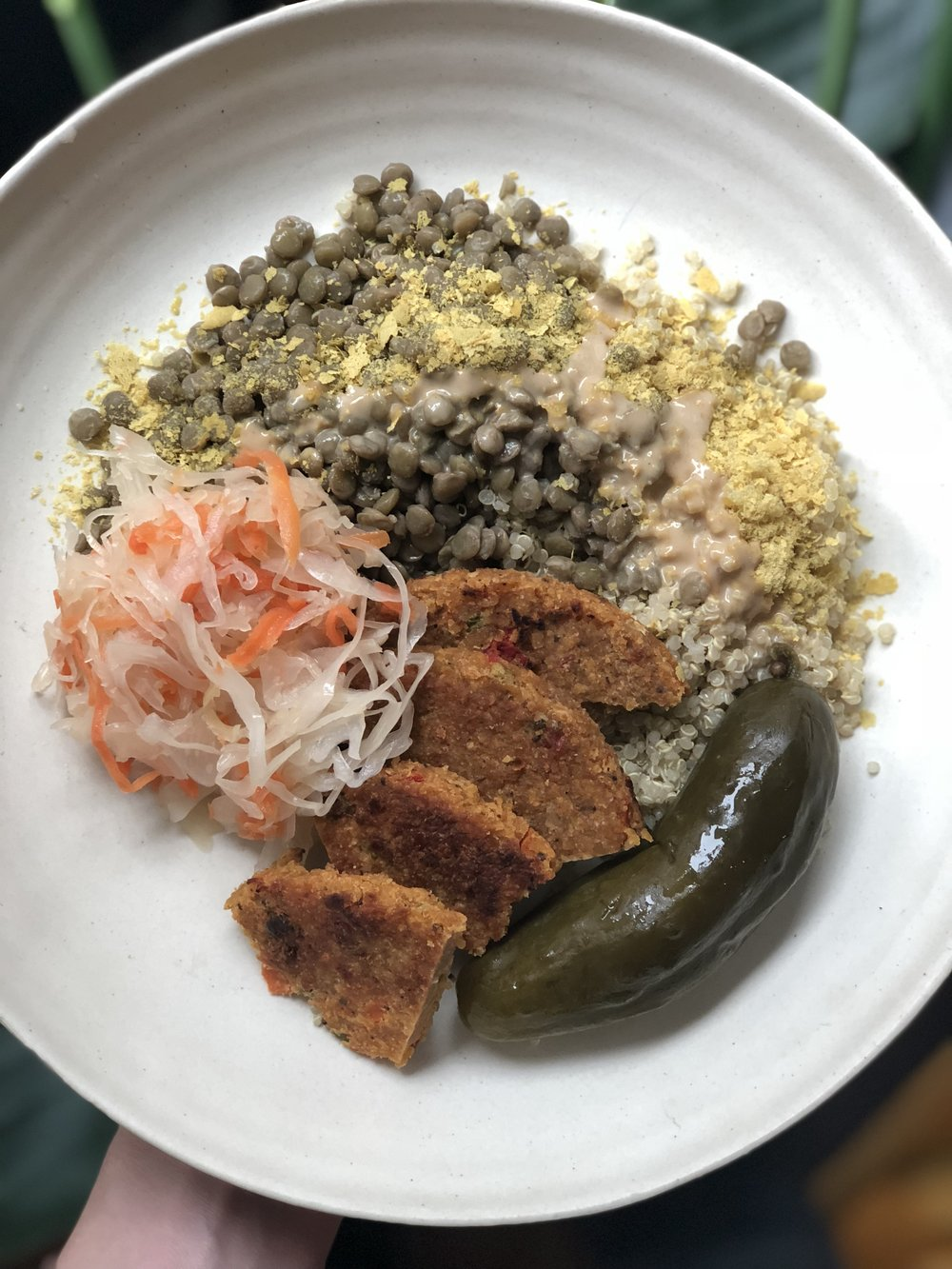 sauerkraut, bubbie's pickle, big mountain veggie patty, lentils, quinoa, nutritional yeast