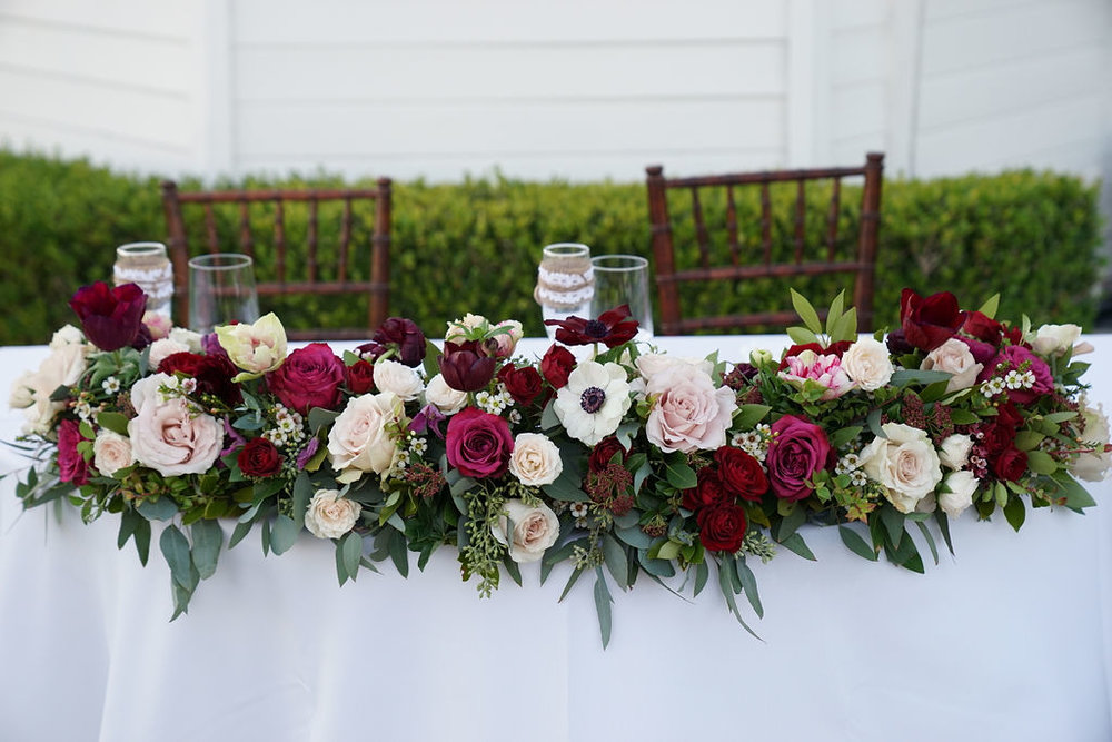 Jewel toned sweetheart table floral garland - Royal Bee Florals and Events