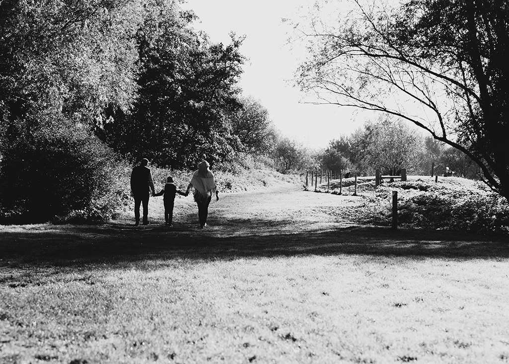 Walking family black and white, Cambridge, Photographer