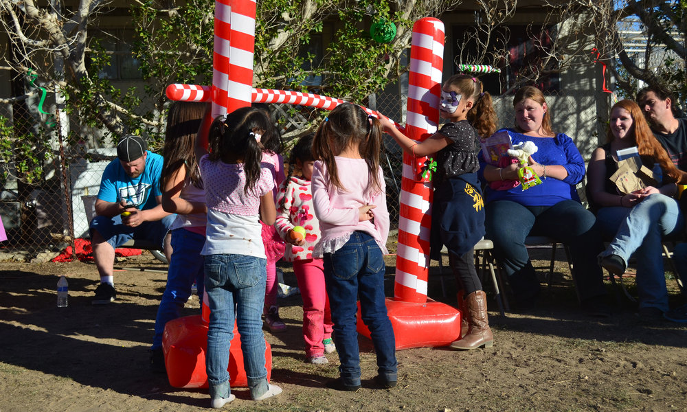 Children play at the Forgotten Angels Christmas party in Niland. (Imperial Valley Press/Antoine Abou-Diwan)