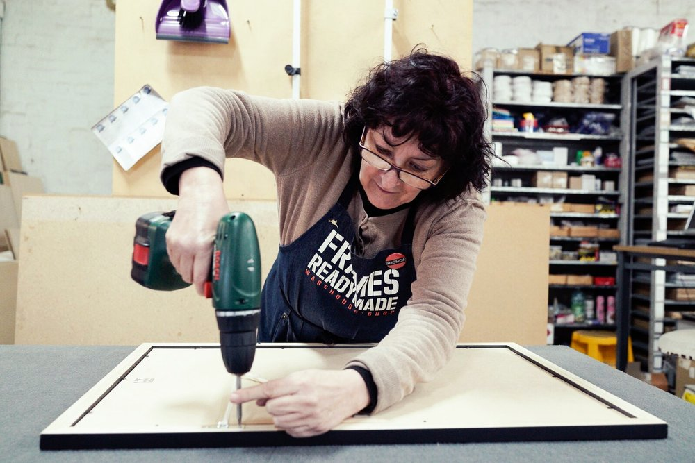 RHONDA  With more than 20 years experience in the framing industry, Rhonda's knowledge (and fine taste) is invaluable. Her endless list of iconic catch phrases have permeated through the entire staff and we are better off for it.