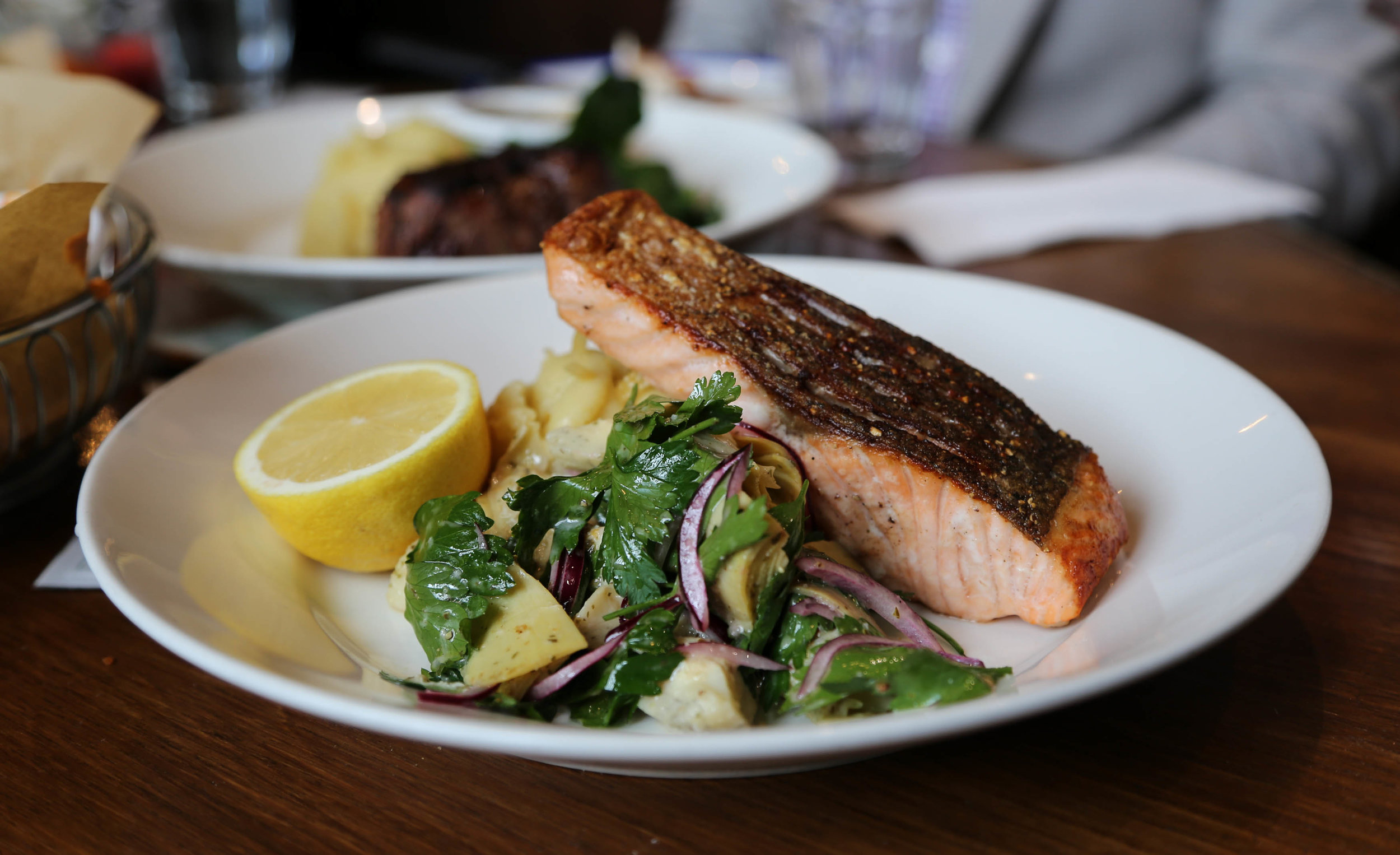 Crispy skin salmon, lemon mash, artichoke, parsley salad (gf) $22