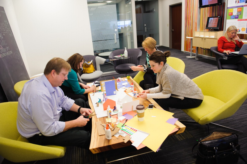 Spinal Cord Injury Team creating a paper diagram of their tool in use