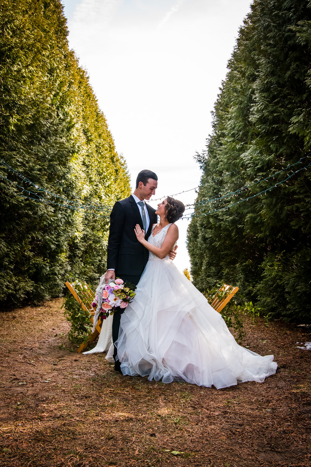 Newlywed couple at Whitetail Tree Farm in Springport, Indiana.