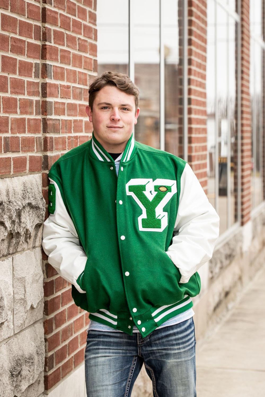 High School Senior wearing Yorktown, Indiana letterman jacket