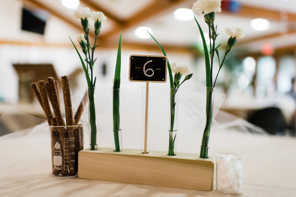 Mini chalkboard table number with flowers.